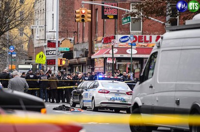 紐約警察遭「暗殺」槍手舉槍自盡 |