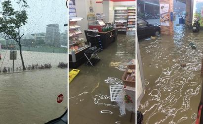 【影】暴雨狂洩 五股多路段水淹半輪胎高   五股淹水連超商也遭殃。